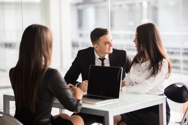 contract with best conditions confident young woman explain some details document pointing it with smile while sitting together with young couple desk office 231208 11705
